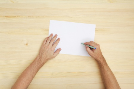 copy writing: man writing on the paper, top view