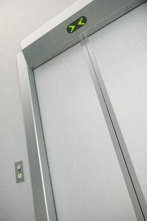 hotel hall: modern elevator with closed doors Stock Photo