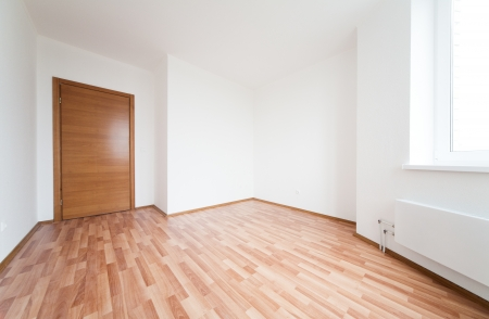 apartment living: white empty room with door