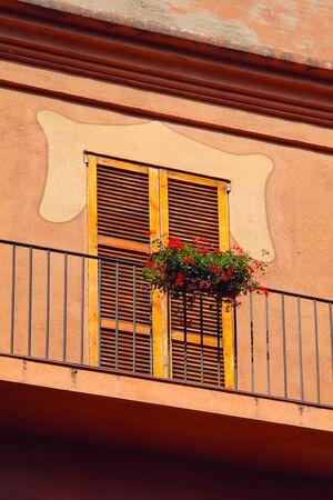 small balcony on the facade of building photo