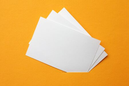 white paper cards on orange background photo