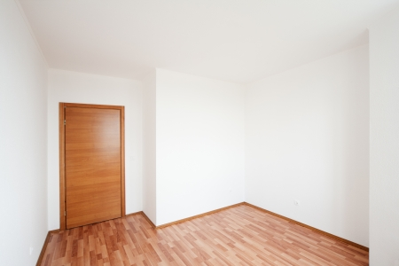 white empty room with door photo