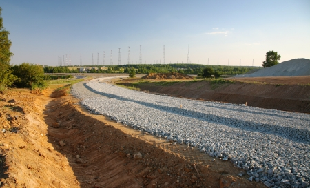 gravel roads: building a new highway Stock Photo