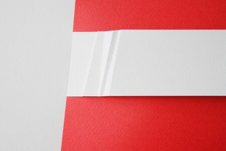 white paper card on red background photo