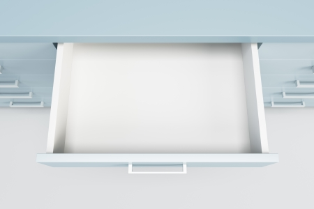 cupboard with opened empty drawer Stock Photo