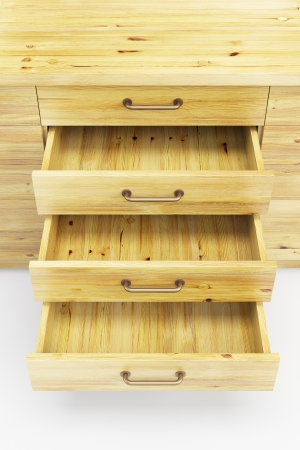 wooden cupboard with opened empty drawers photo