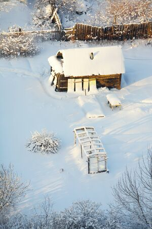 small house under snow photo