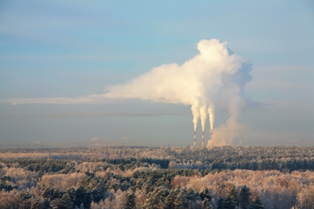 industrial smoke from chimney at winter landscape Stock Photo