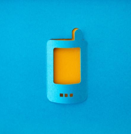 communicator: mobile phone paper symbol Stock Photo