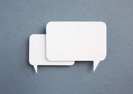 thought bubble: paper speech bubble on grey  background