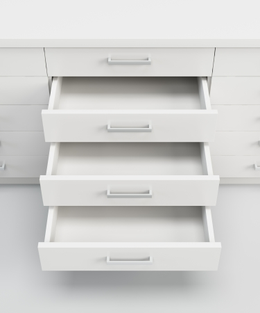 white cupboard with opened empty drawers photo