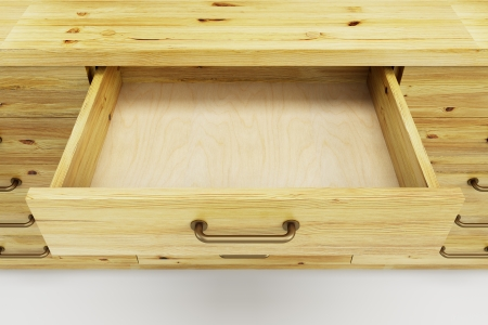 houten kast met geopende lege lade Stockfoto