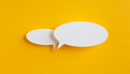 communicate concept: paper speech bubble on yellow background