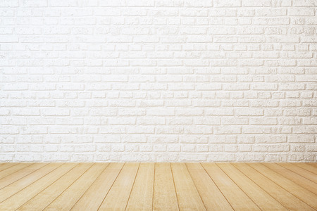 empty room with white brick wall and wooden floor Standard-Bild