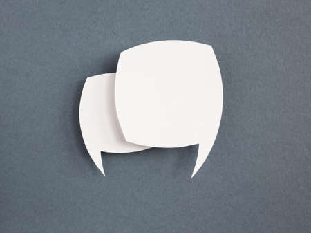paper speech bubble on grey background photo