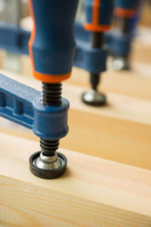 clamps: wood pasting by clamps in a joiner Stock Photo