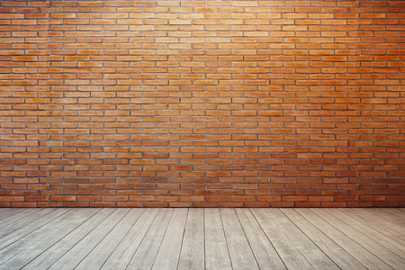 brick wall: empty room with red brick wall and wooden floor Stock Photo