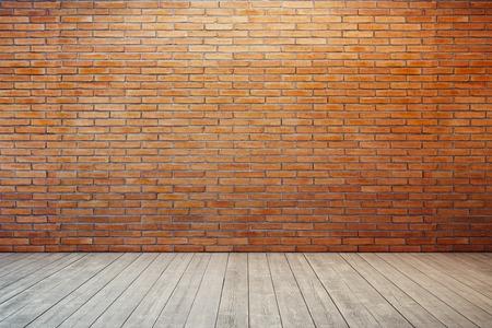 empty room with red brick wall and wooden floor Foto de archivo
