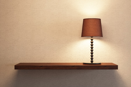 turn table: turn on table lamp on the empty shelf Stock Photo