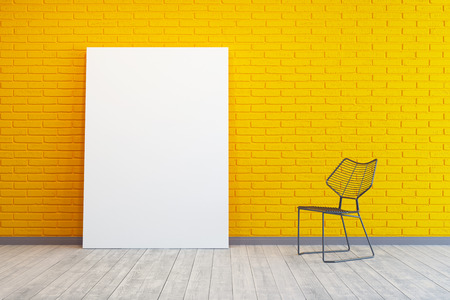 yellow room with blank picture and chair photo