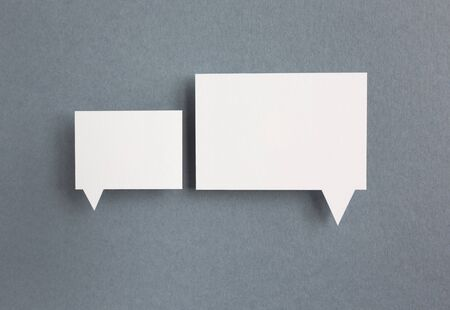 thought clouds: paper speech bubbles on grey background