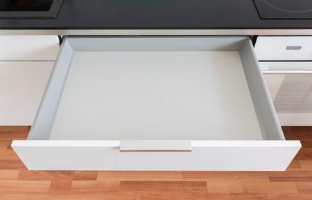 opened white empty drawer Standard-Bild