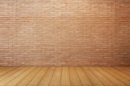 赤レンガの壁とフローリングの床と空の部屋 写真素材