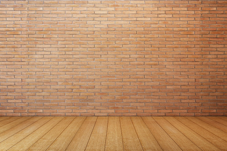 empty room with red brick wall and wooden floor Stockfoto