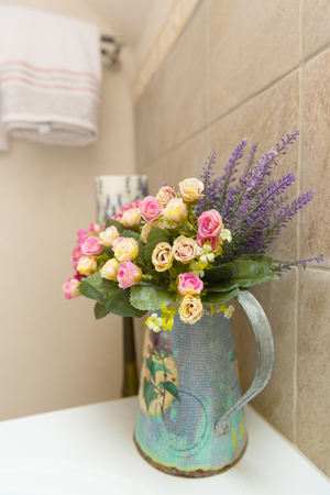 Vase with flovers in bathroom Stock Photo