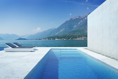 A luxury modern backyard with a swimming pool 写真素材