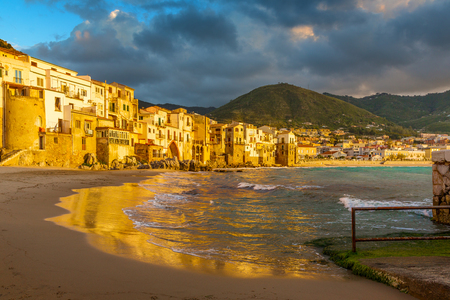 Cefalu town and beach at sunset light, Sicily, Italy