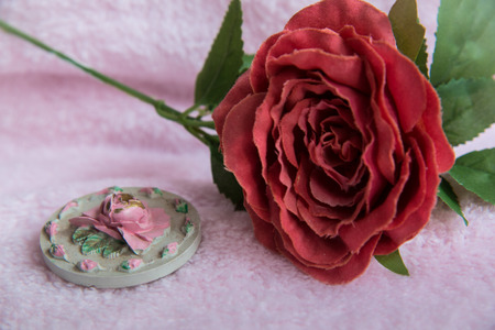 Pink rose on the pink fabric Stock Photo