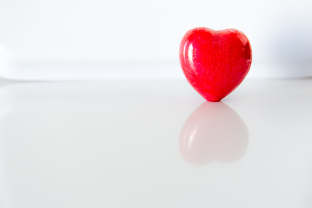 Red heart with reflections on the white background