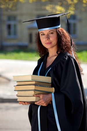 The graduate of university with books about library photo