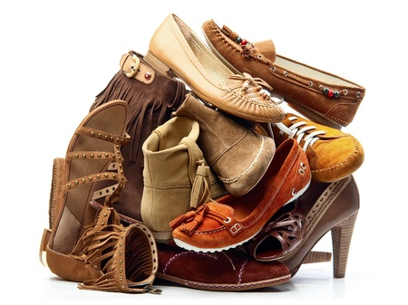 Pile of brown female shoes isolated on white background Stock Photo - 8679535