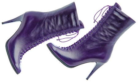 Two female violet boots on white background. Isolated with paths Stock Photo - 8678781