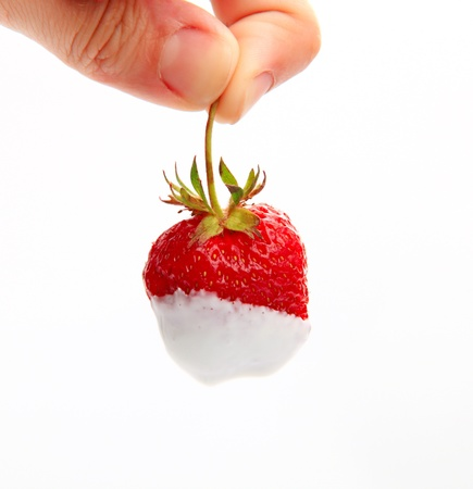 dipped: Close-up image of strawberry dipped into sour cream