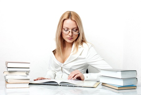 Young pretty woman learning at table with books photo