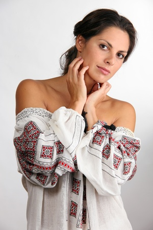 chemise: Beautiful young woman in embroided chemise