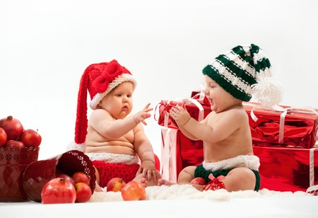 christmas toys: Two cute babies in Christmas costumes  Stock Photo
