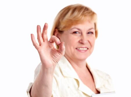 Cheerful mature woman showing the ok sign photo