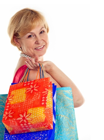 Pretty mature lady carrying shopping bags photo