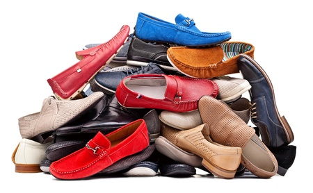 messy clothes: Pile of various men shoes, with clipping path