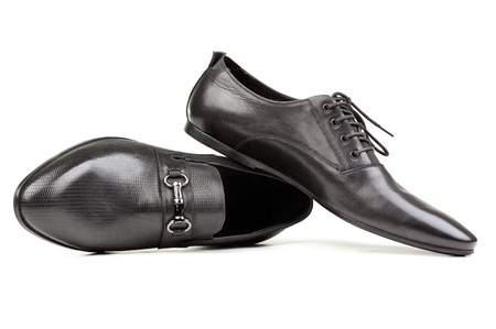 Two black men shoes against white photo