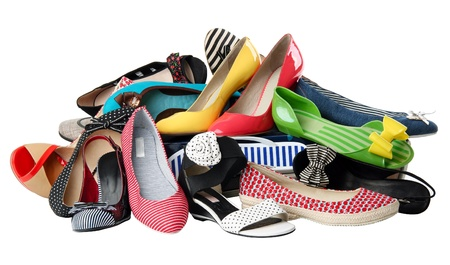 clutter: Pile of various female summer shoes, with path