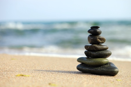 still water: Stack of sea pebbles on the beach