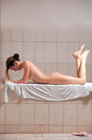 naked young girl: Young woman enjoying hamam or turkish bath  Stock Photo