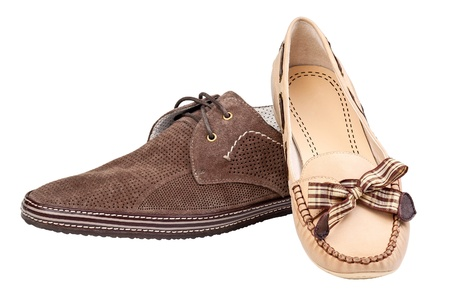 Male suede shoe and female loafer, with path  photo