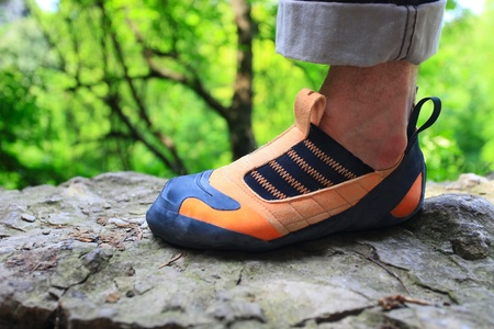 Rock climbers foot in climbing shoe photo