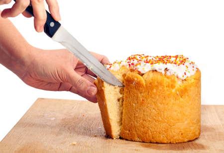 paskha: Cropped view of female cutting Easter cake